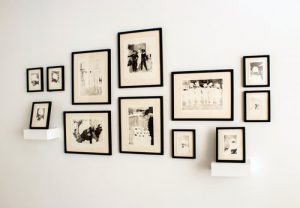 Black and white photographs on white wall