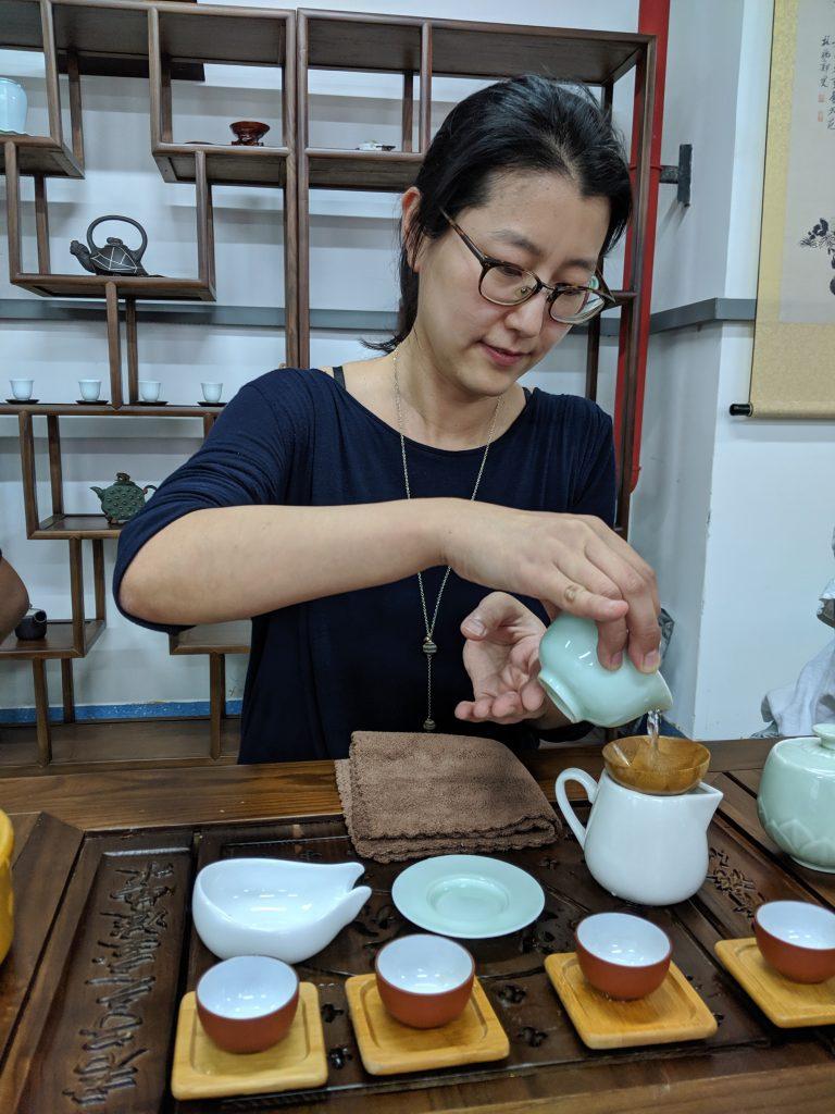 Professor pouring tea