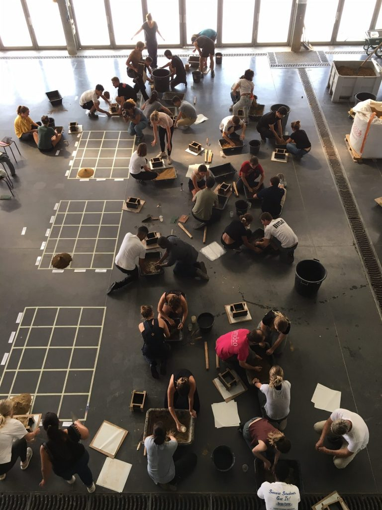 aerial view students working on floor