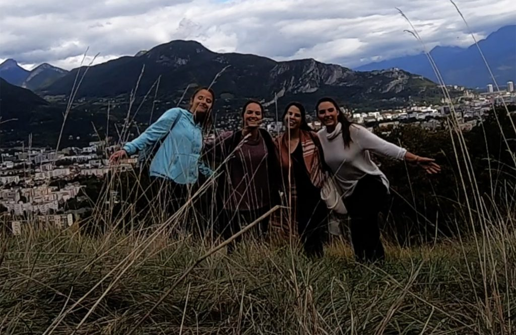 smiling girls, mountains in background