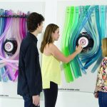 People observe colored art installation