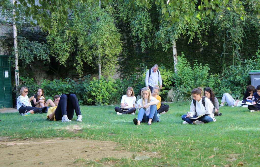 students drawing in park