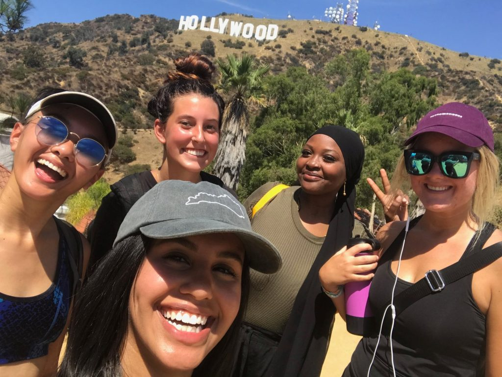 smiling students by Hollywood sign