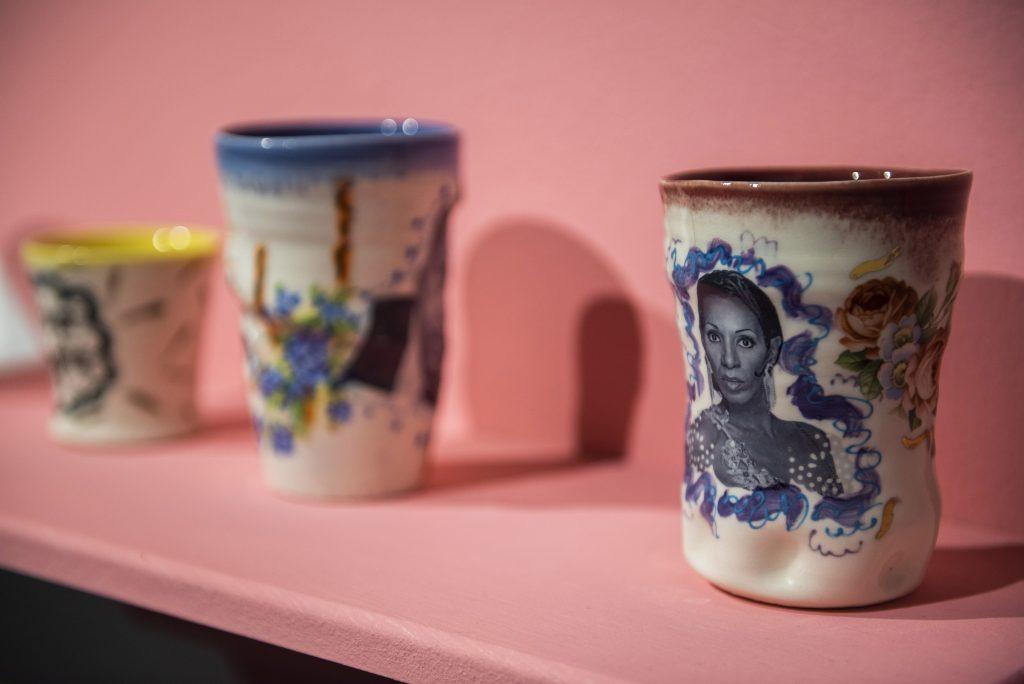 Mugs on pink shelf