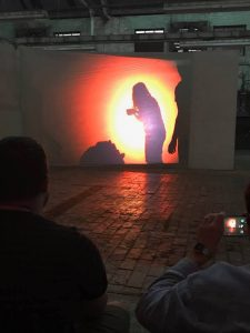 Performance art piece with glowing screen