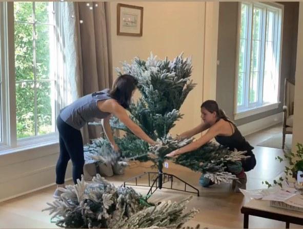 two women assembling install