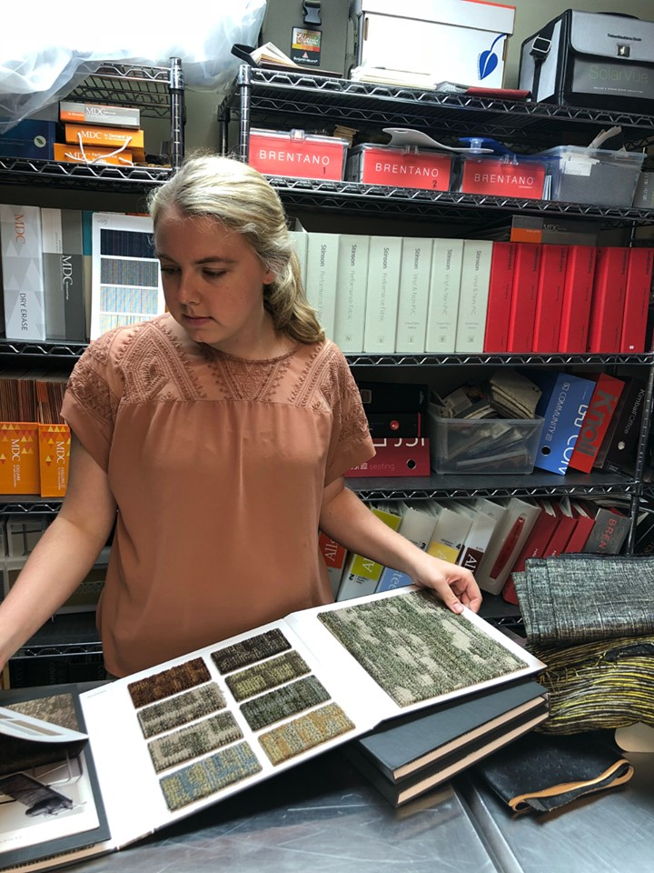 girl with binder of fabric samples