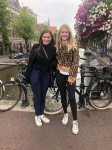 two girls by canal in Amsterdam