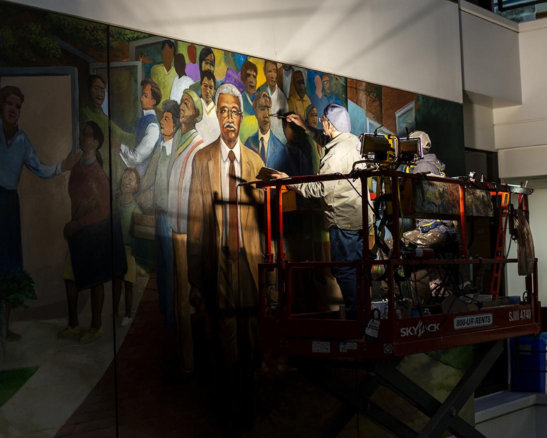 Man painting mural