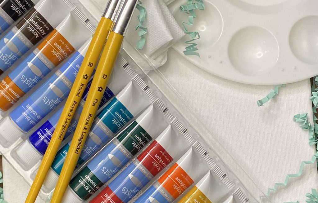 Paint brushes and colored paint tubes