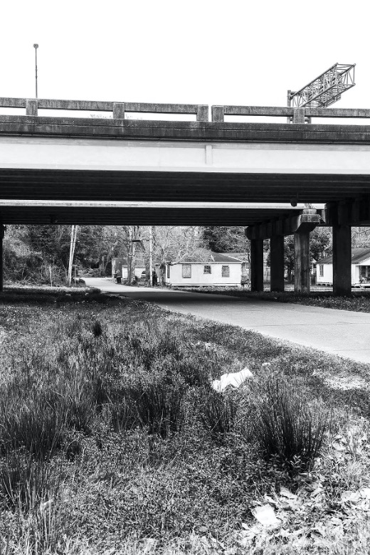 Black and white photo of highway overpass