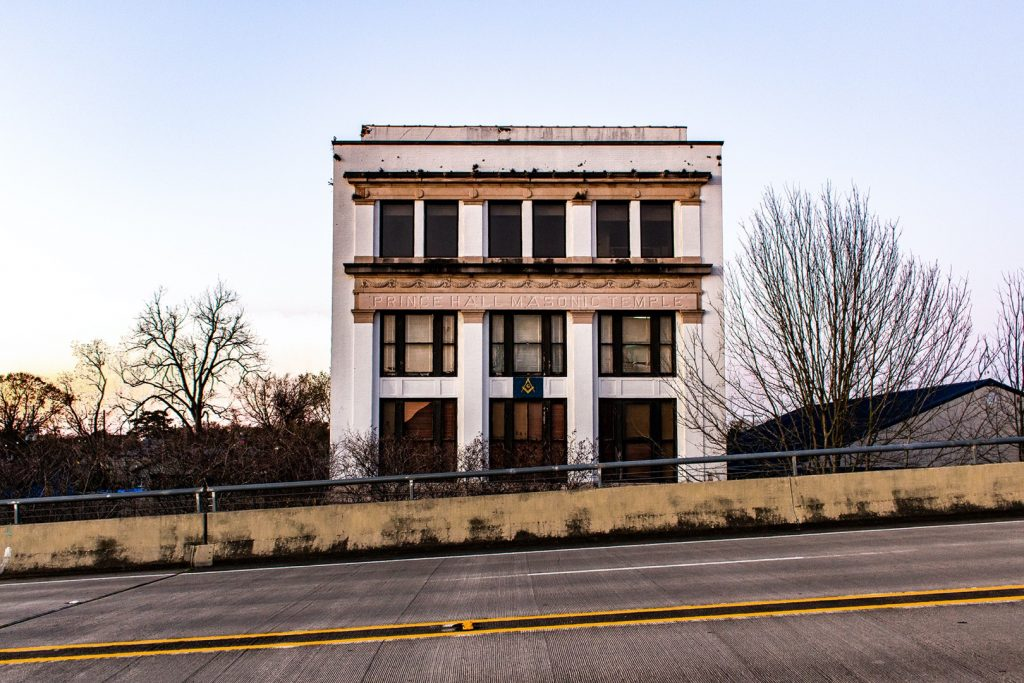 photo of old building by highway