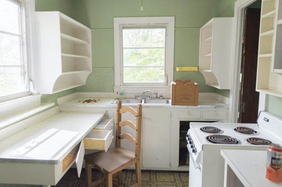 Photo of kitchen interior, green walls and old-fashioned appliances