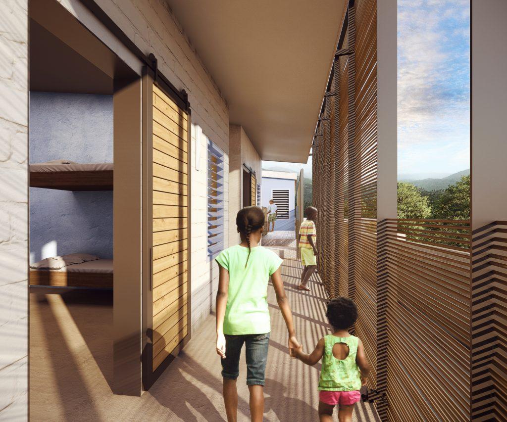 Children walking on second floor exterior corridor.