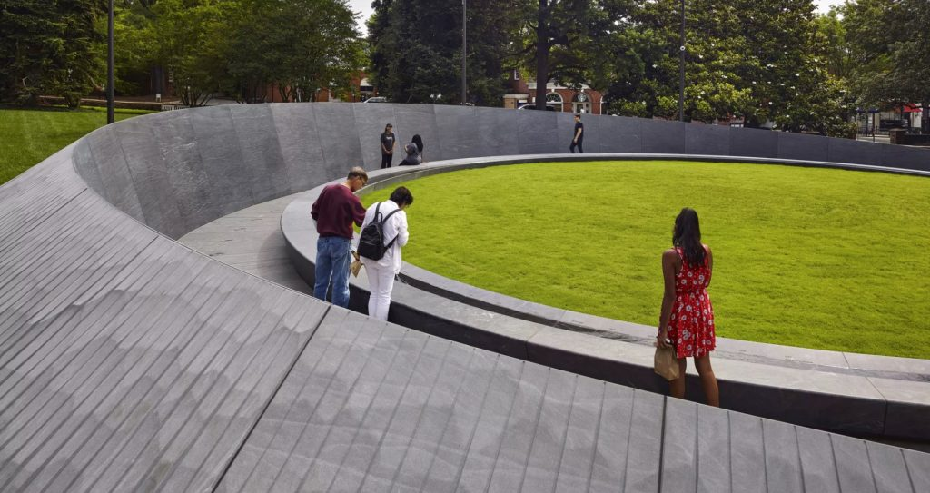 Visitors viewing memorial