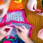 Hands knitting bright yarn