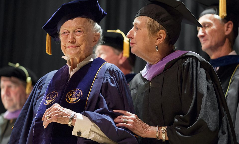 Woman in graduation robe and cap