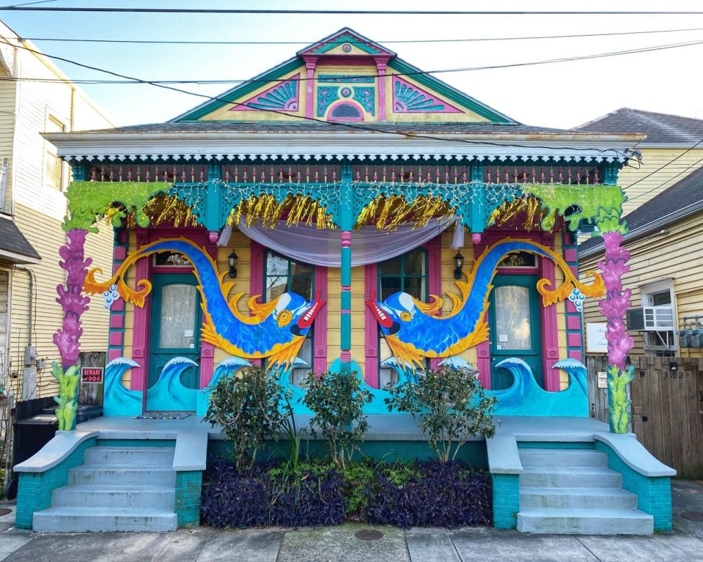 New Orleans house decorated with colorful Mardi Gras sculptures