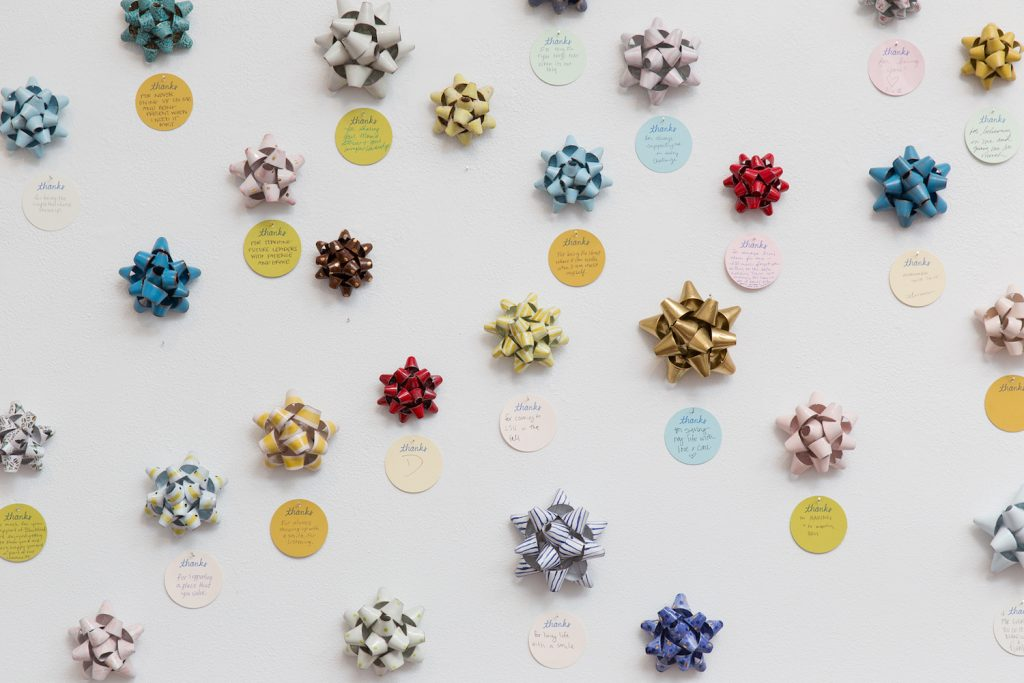 Red, gold, and blue ceramic bows and thanks notes