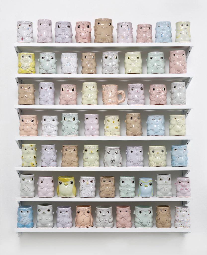 Ceramic cups shaped like animals (owls, monkeys, birds) in pastels