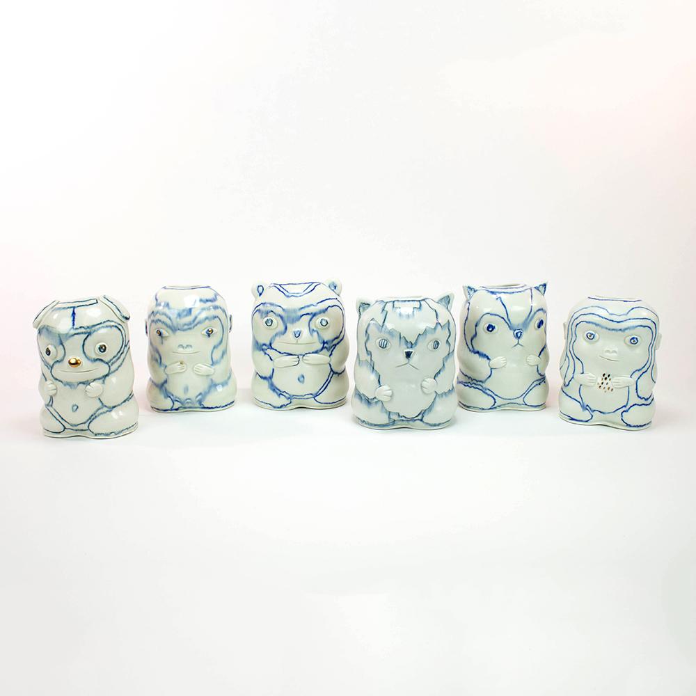 White ceramic creatures with blue details