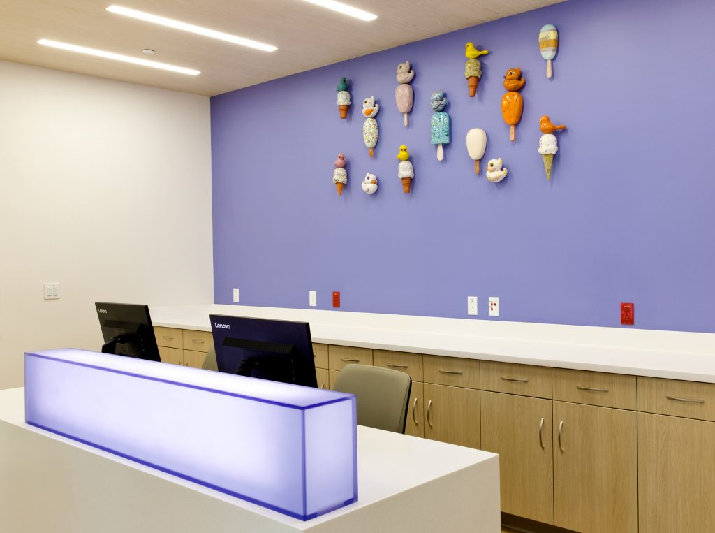 Ice cream sculptures on purple wall