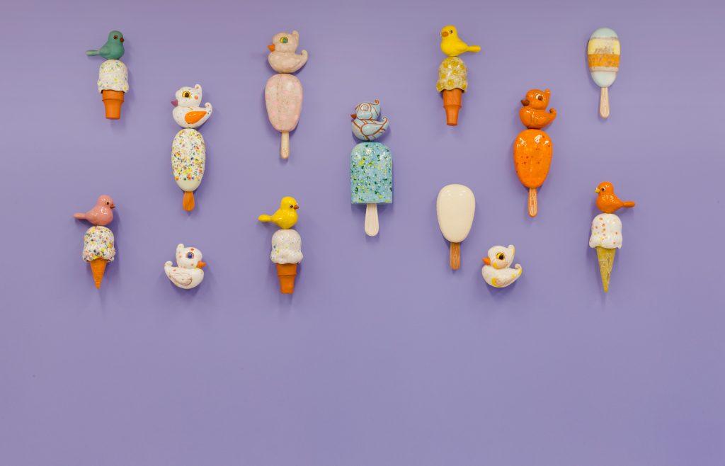 Ceramic ice cream cones and birds on lavender purple wall