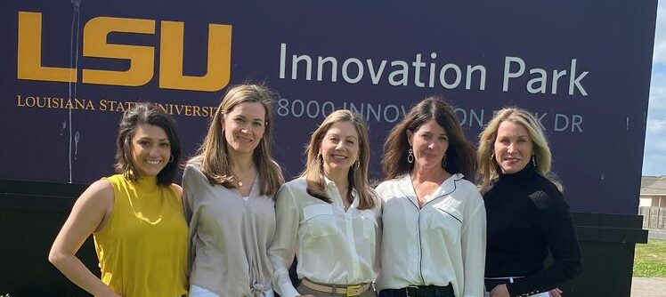 Women stand in front of LSU Innovation Park sign