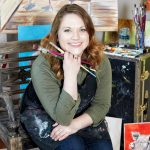 Jessica Young with paintbrushes
