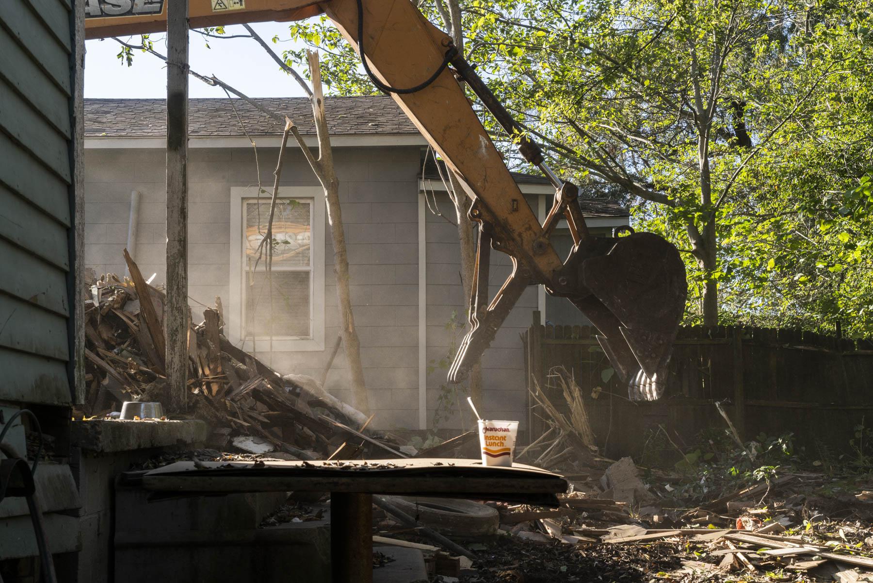 Photo of bulldozer demolishing building, by Johanna Warwick