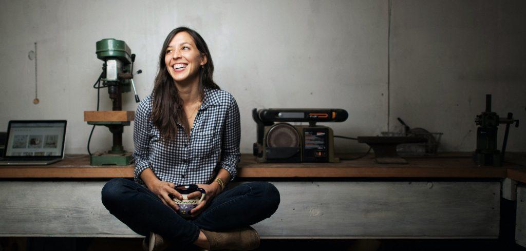 Woman seated with mug