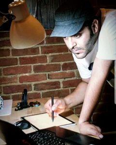 Farshid working at desk