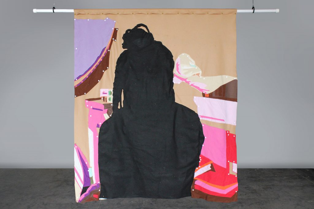 Back of cloth print with dark human shape