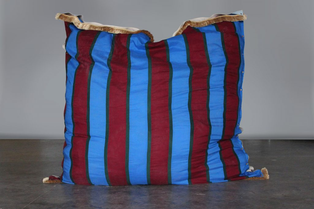 Red and blue striped pillow
